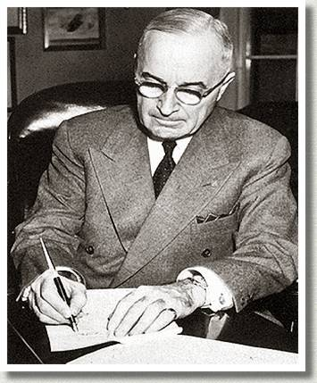 U.S. President Harry S. Truman at His Desk, Washington, D.C., 16 December 1950.