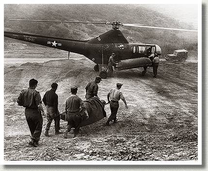 Stretcher-Bearers Transport a Casualty to a U.S. Air Force Helicopter, Korea, 22 June 1952.