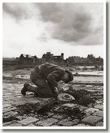 Officer Removing a Land Mine from the Harbour Road, Dieppe, France, 5 September 1944.