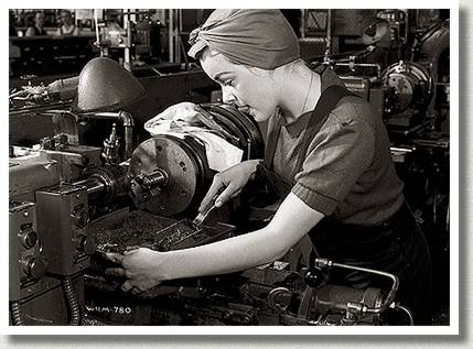 Veronica Foster Operates a Lathe on the Bren Gun Production Line, Toronto, Ontario, 10 May 1941.