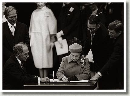 The Prime Minister, Pierre Trudeau, and Queen Elizabeth II Sign the Canadian Constitution, Ottawa, Ontario, 17 April 1982.