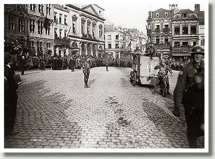 Procession of Canadian Armoured Cars, Mons, Belgium, November 1918.