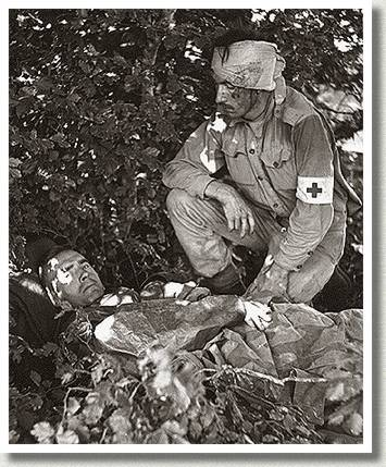 Private W.E. Dexter Attends to Wounded Medical Officer, Captain A.W. Hardy, Santa Cristina, Italy, September 1943.